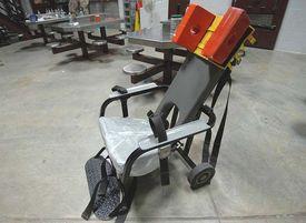 800px-Restraint_chair_used_for_enteral_feeding_-b.jpg